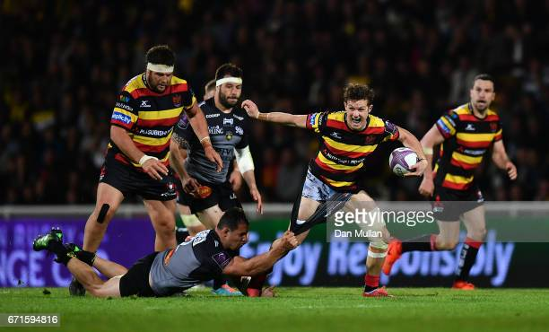 Billy Burns of Gloucester is tackled by Jeremie Maurouard of La Rochelle during the European Rugby Challenge Cup Semi Final match between La Rochelle...