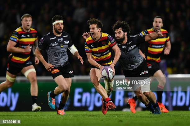 Billy Burns of Gloucester looks for a pass under pressure from Kevin Gourdon of La Rochelle during the European Rugby Challenge Cup Semi Final match...