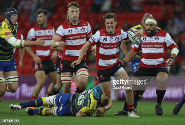 Billy Burns of Gloucester Rugby breaks through the Cardiff Blues defence during the European Rugby Challenge Cup Final match between Cardiff Blues...