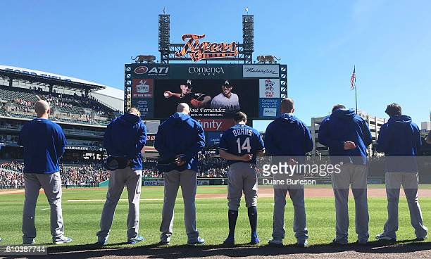 Billy Burns of the Kansas City Royals and teammates bow their heads in a moment of silence for Miami Marlins pitcher Jose Fernandez who was killed...