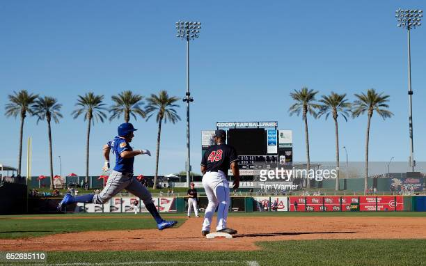 Billy Burns of the Kansas City Royals runs to first as Boone Logan of the Cleveland Indians awaits a throw during a spring training game at Goodyear...