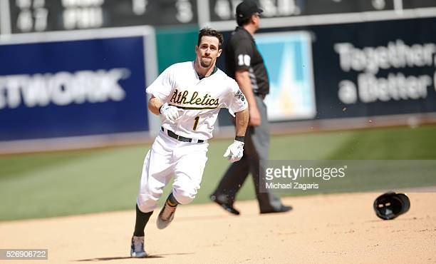 Billy Burns of the Oakland Athletics heads to third on a triple during the game against the Kansas City Royals at the Oakland Coliseum on April 17...