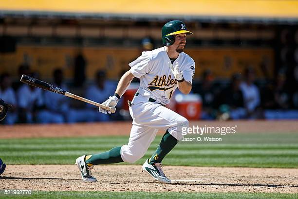 Billy Burns of the Oakland Athletics hits a triple against the Kansas City Royals during the eighth inning at the Oakland Coliseum on April 17 2016...