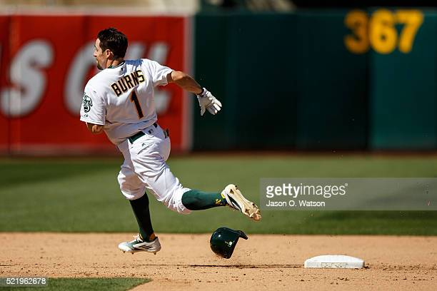 Billy Burns of the Oakland Athletics rounds second base after hitting a triple against the Kansas City Royals during the eighth inning at the Oakland...