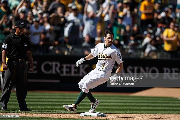 Billy Burns of the Oakland Athletics runs to third base after hitting a triple against the Kansas City Royals during the eighth inning at the Oakland...