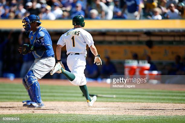 Billy Burns of the Oakland Athletics scores during the game against the Kansas City Royals at the Oakland Coliseum on April 17 2016 in Oakland...