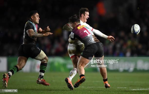 Billy Burns of Ulster avoids a tackle from Brett Herron of Harlequins during the Heineken Champions Cup Round 4 match between Harlequins and Ulster...