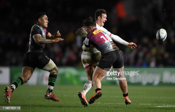 Billy Burns of Ulster avoids a tackles from Brett Herron of Harlequins during the Heineken Champions Cup Round 4 match between Harlequins and Ulster...