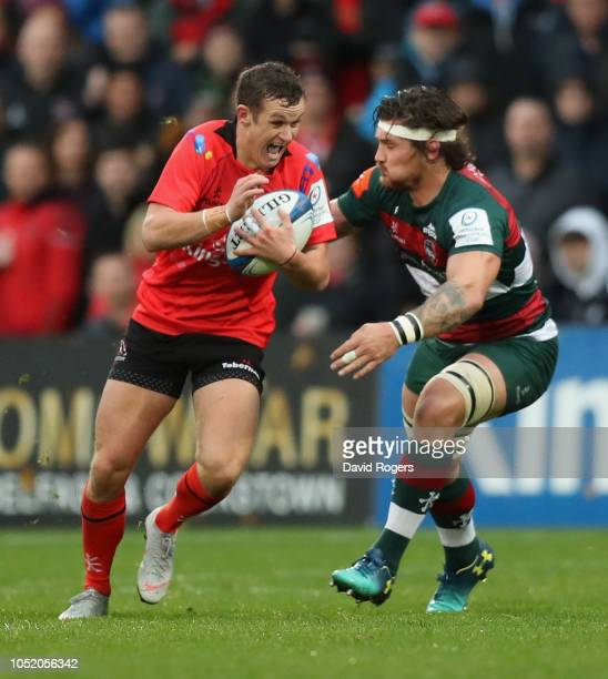 Billy Burns of Ulster goes past Guy Thompson during the Champions Cup match between Ulster Rugby and Leicester Tigers at the Kingspan Stadium on...