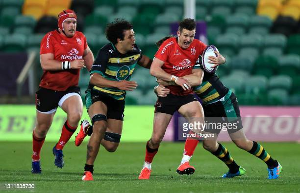 Billy Burns of Ulster is tackled by Dan Biggar and Lewis Ludlam during the European Rugby Challenge Cup, quarter final match between Northampton...