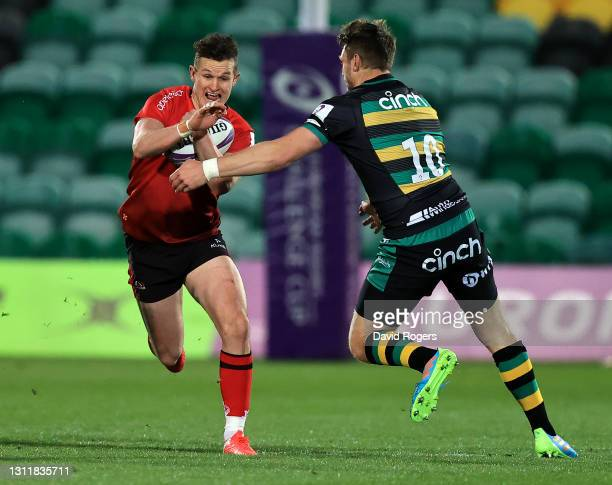 Billy Burns of Ulster is tackled by Dan Biggar during the European Rugby Challenge Cup, quarter final match between Northampton Saints and Ulster at...