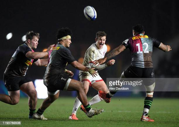 Billy Burns of Ulster offloads the ball during the Heineken Champions Cup Round 4 match between Harlequins and Ulster Rugby at Twickenham Stoop on...