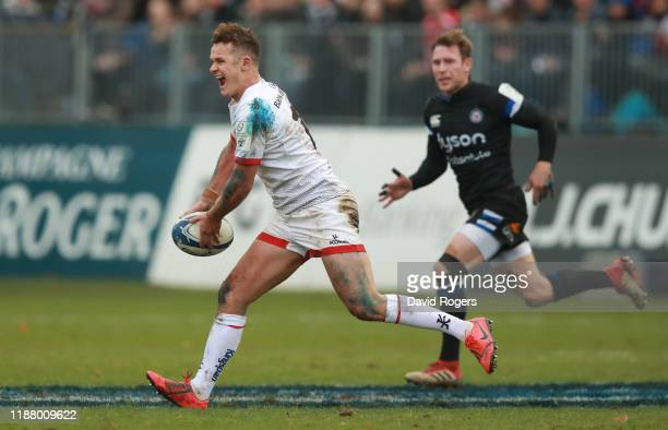 Billy Burns of Ulster passes the ball during the Heineken Champions Cup Round 1 match between Bath Rugby and Ulster Rugby at the Recreation Ground on...