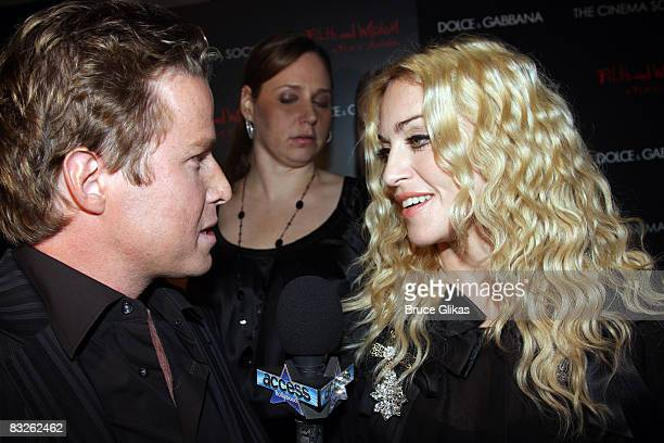 Billy Bush and Madonna pose at a screening of Filth and Wisdom hosted by The Cinema Society and Dolce and Gabbana at the Sunshine IFC Center on...