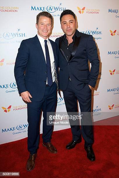 Billy Bush and Oscar De La Hoya arrive at MakeAWish Greater Los Angeles honors Oscar De La Hoya Michael Rosenfeld and Tom Mone at its annual Wishing...