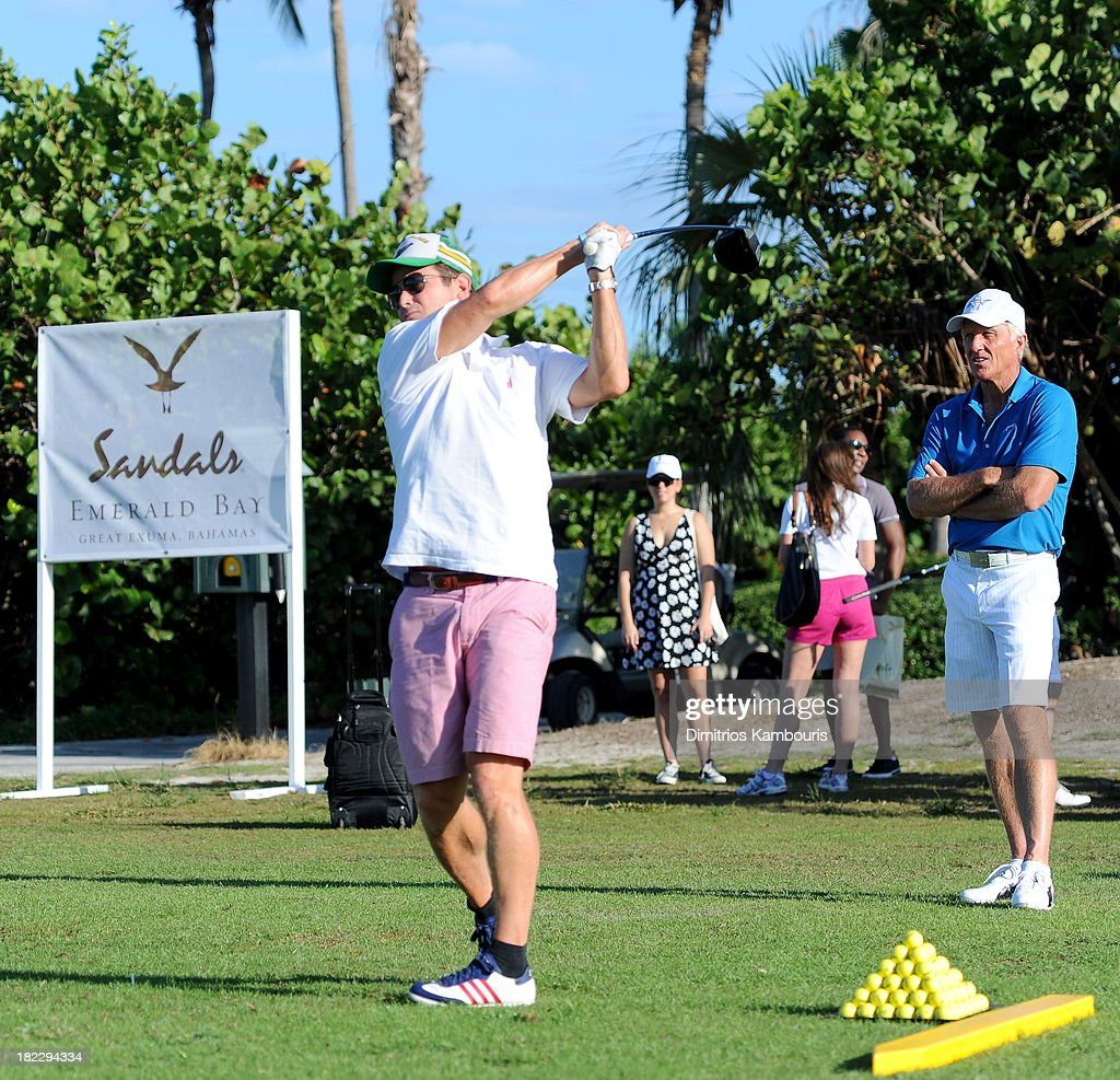 Billy Bush (L) and Professional Golfer Greg Norman (R) attend the Golf Clinic with Greg Norman and Golf Tournament during Day Three of the Sandals Emerald Bay Celebrity Getaway And Golf Weekend on September 29, 2013 at Sandals Emerald Bay in Great Exuma, Bahamas.