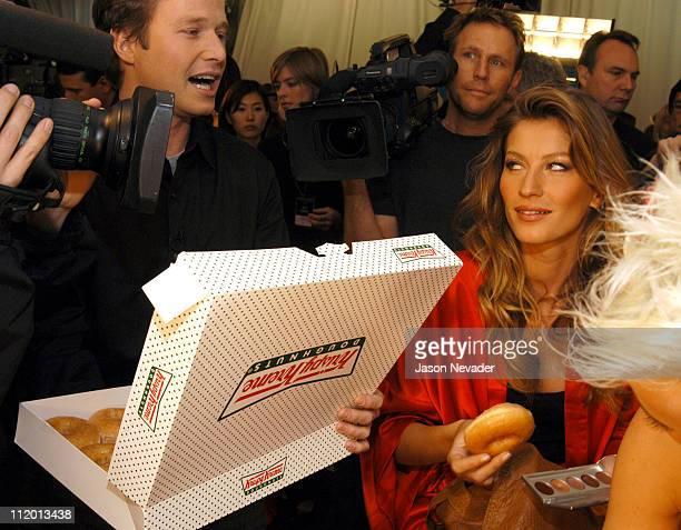 Billy Bush offers Krispy Kreme donuts to Gisele Bundchen