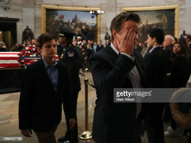 Billy Bush walks away after paying his respects in front of the casket of his uncle the late former President George HW Bush as he lies in state in...