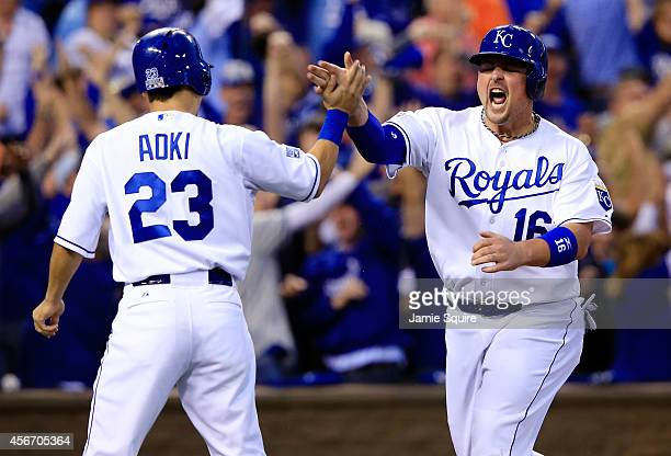 Billy Butler celebrates with Norichika Aoki of the Kansas City Royals after scoring in the first inning against the Los Angeles Angels during Game...