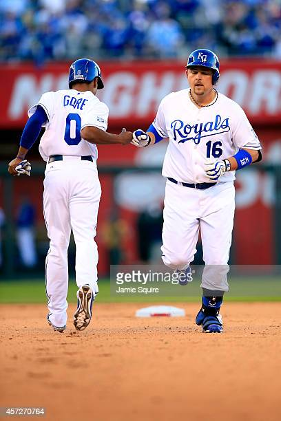 Billy Butler of the Kansas City Royals celebrates with runner Terrance Gore after hitting a double to left center field in the eighth inning against...