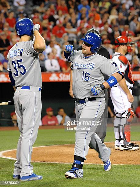 Billy Butler of the Kansas City Royals celebrates with teammate Eric Hosmer after hitting a homerun in the sixth inning against the Los Angeles...