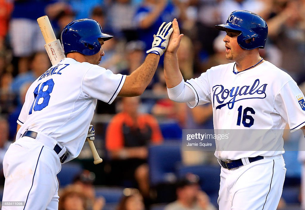 Billy Butler #16 of the Kansas City Royals is congratulated by Raul Ibanez #18 after scoring during the 7th inning of the game against the San Francisco Giants at Kauffman Stadium on August 9, 2014 in Kansas City, Missouri.