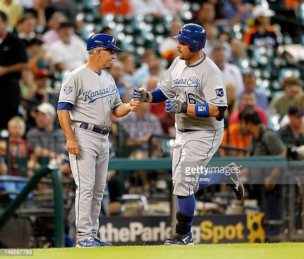 Billy Butler of the Kansas City Royals receives congratulations from third base coach Eddie Rodriguez after hitting a home run in the first inning...
