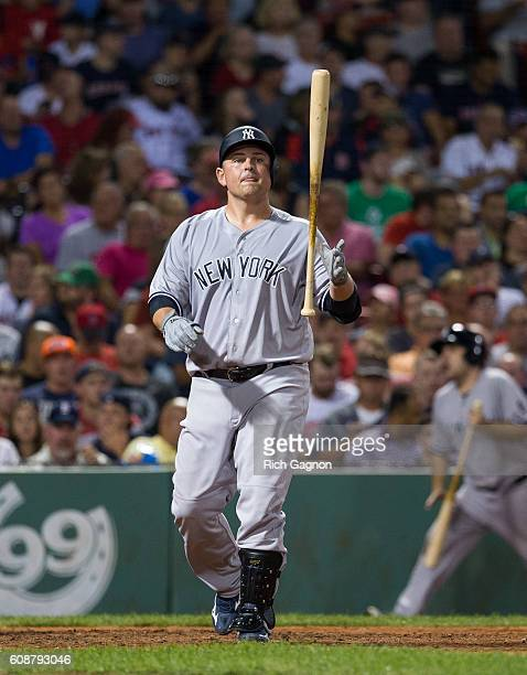 Billy Butler of the New York Yankees reacts after swinging and missing a pitch during the fourth inning against the Boston Red Sox at Fenway Park on...