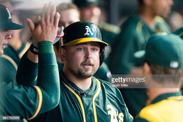Billy Butler of the Oakland Athletics celebrates in the dugout after hitting a solo home run during the fourth inning against the Cleveland Indians...