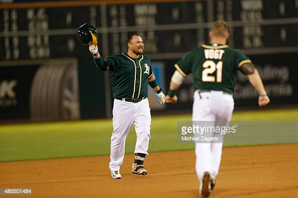 Billy Butler of the Oakland Athletics celebrates on the field after hitting a walkoff double the game against the Los Angeles Dodgers at Oco Coliseum...