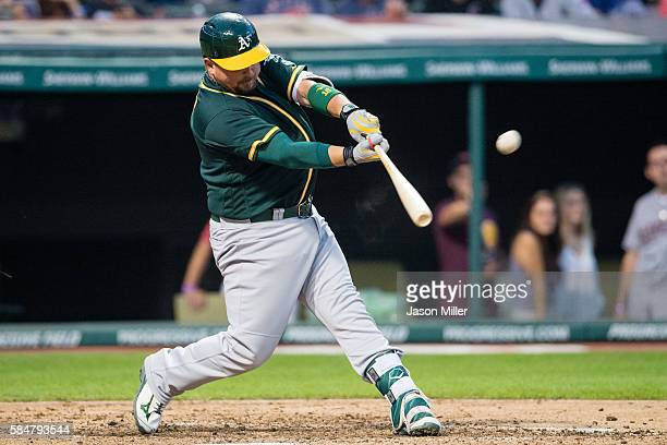 Billy Butler of the Oakland Athletics hits a solo home run during the fourth inning against the Cleveland Indians at Progressive Field on July 30...