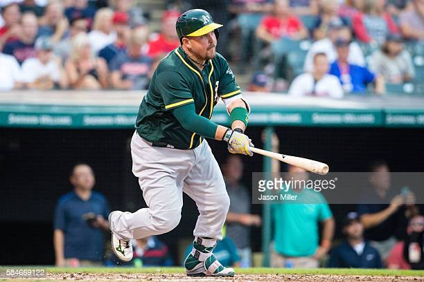 Billy Butler of the Oakland Athletics hits an RBI single during the fourth inning against the Cleveland Indians at Progressive Field on July 29 2016...