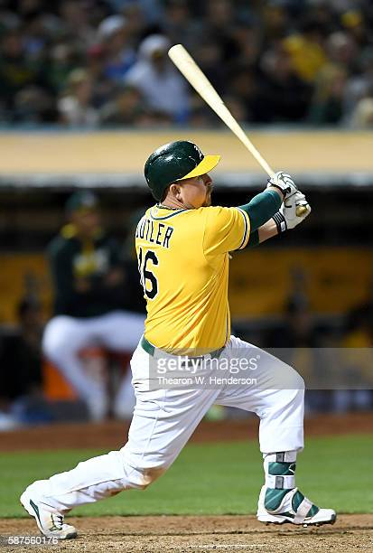 Billy Butler of the Oakland Athletics hits an rbi single scoring Stephen Vogt against the Baltimore Orioles in the bottom of the six inning at theh...