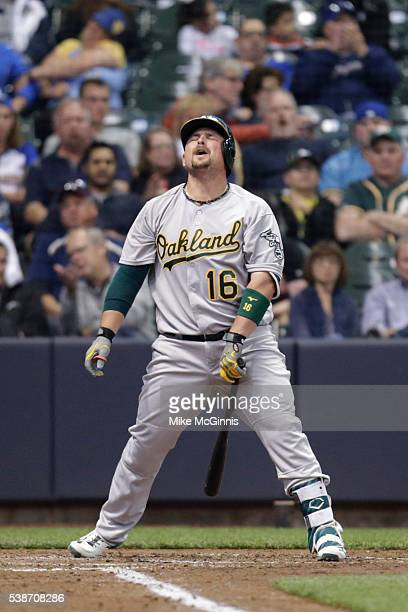Billy Butler of the Oakland Athletics reacts after striking out during the fourth inning of the Interleague game against the Milwaukee Brewers at...