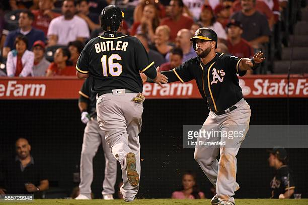 Billy Butler of the Oakland Athletics scores in the fourth inning against the Los Angeles Angels of Anaheim at Angel Stadium of Anaheim on August 3...