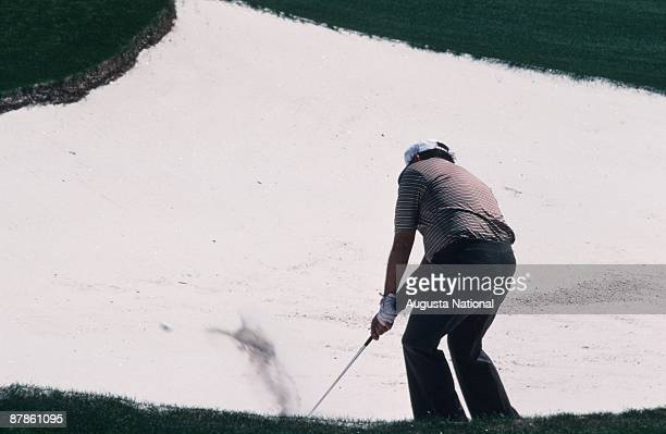 Billy Casper chips out of a bunker during the 1979 Masters Tournament at Augusta National Golf Club in April 1979 in Augusta Georgia