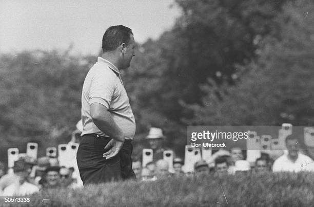 Billy Casper during the US open golf championship as fans in background look on