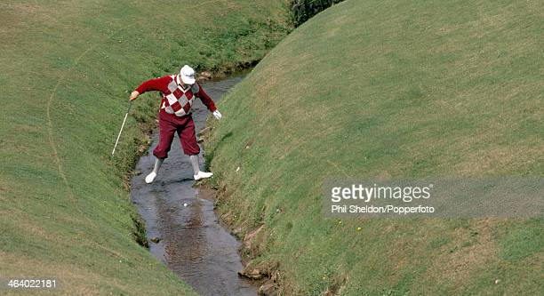 Billy Casper of the United States negotiates a bad lie during the Senior PGA Championship held at the PGA National Golf Club in Florida circa 1989