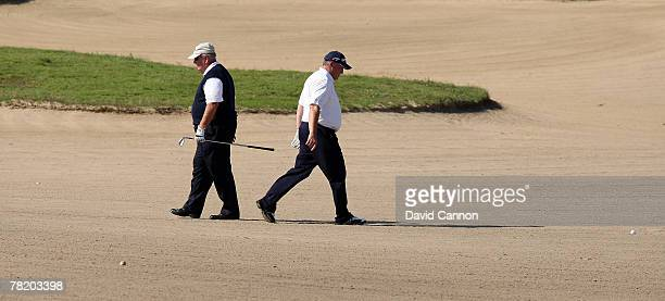 Billy Casper passes his son Bob Casper in a huge bunker at the 13th hole during the first round of the 2007 Del Webb Father Son Challenge on the...
