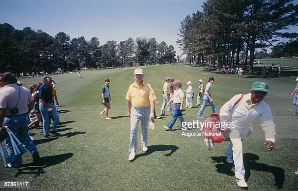 Billy Casper walks up the fairway with his caddie during the 1978 Masters Tournament at Augusta National Golf Club on April 1978 in Augusta Georgia