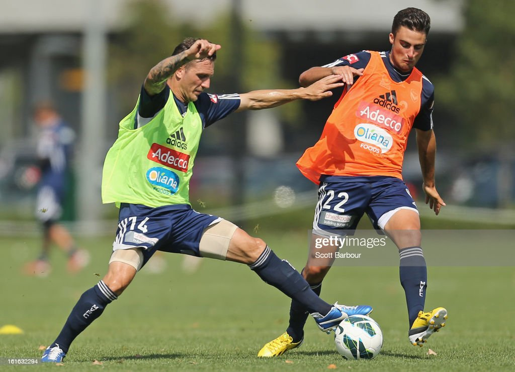 Billy Celeski (L) and Jesse Makarounas of the Victory compete for the ball during a Melbourne Victory A-League training session at Gosch's Paddock on February 14, 2013 in Melbourne, Australia.