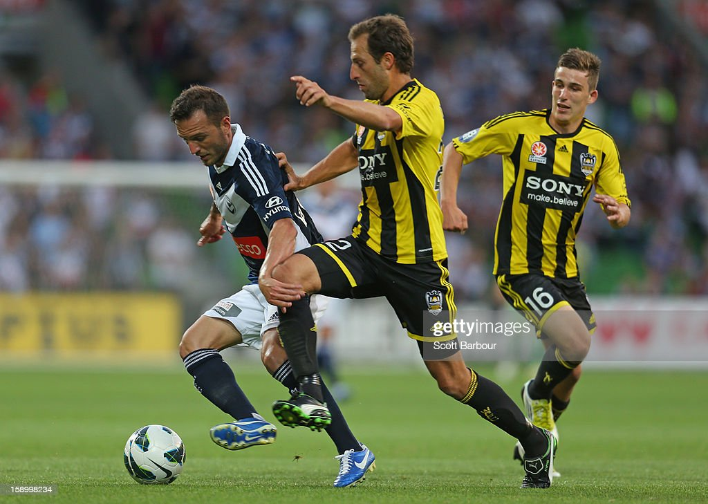 Billy Celeski of the Victory and Andrew Durante of the Phoenix compete for the ball during the round 15 A-League match between the Melbourne Victory and Wellington Phoenix at AAMI Park on January 5, 2013 in Melbourne, Australia.