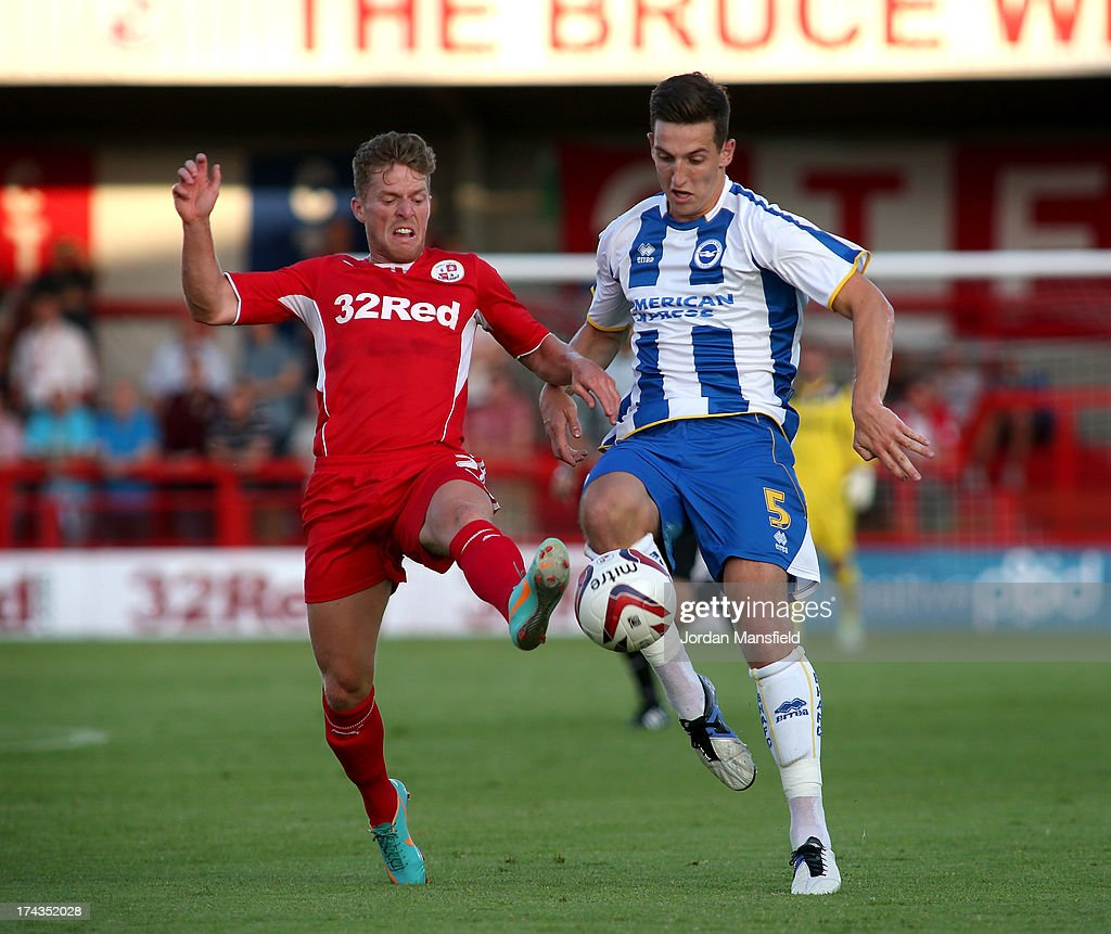 Billy Clarke (L) challenges for the ball with Lewis Dunk (R) at Broadfield Stadium on July 24, 2013 in Crawley, West Sussex.