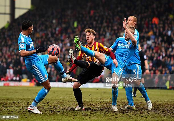 Billy Clarke of Bradford attempts to control the ball under pressure from Liam Bridcutt Sebastian Larsson and Wes Brown of Sunderland during the FA...