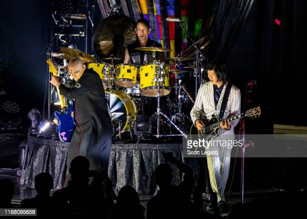 Billy Corgan Jimmy Chamberlin and James Iha of Smashing Pumpkins perform at DTE Energy Music Theater on August 14 2019 in Clarkston Michigan