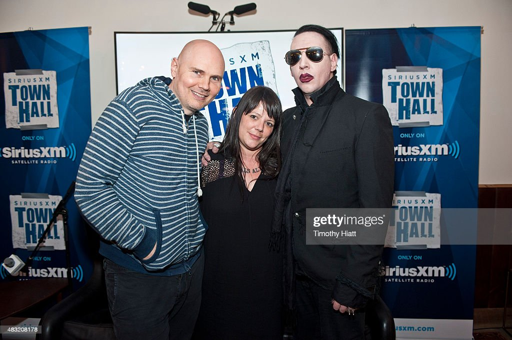 Billy Corgan, SiriusXM's Jenny Eliscu, and Marilyn Manson attend SiriusXM's Town Hall With Marilyn Manson And Billy Corgan on August 6, 2015 in Chicago, Illinois.