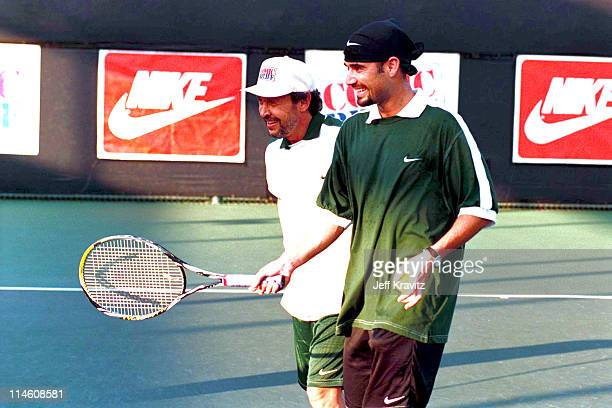 Billy Crystal and Andre Agassi during HBO's Comic Relief Tennis Tournament with Andre Agassi at UCLA in Los Angeles CA United States