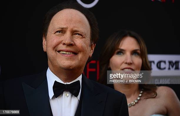Billy Crystal and his wife Janice pose on arrival at the American Film Institutes 41st Life Achievement Award Gala Tribute at the Dolby Theater in...