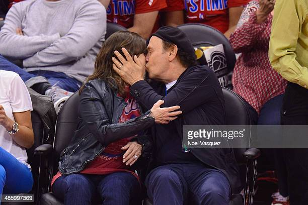 Billy Crystal kisses his wife Janice Crystal at a playoff basketball game between the Golden State Warriors and the Los Angeles Clippers at Staples...