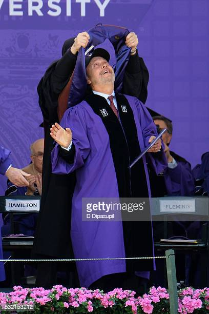 Billy Crystal receives an honorary doctorate degree during the 2016 New York University Commencement Ceremony at Yankee Stadium on May 18 2016 in New...
